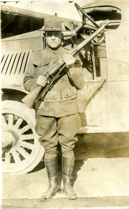 Decker Myles, Grandfather of Jim Myles, stand with rifle. Location unknown. Year unknown.