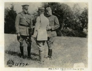 Lt. Faye Palmer (far left) with General William Haan, commander of the 32nd Division (far right).