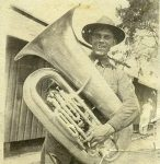 Walter Schrader with the tuba he played in the soldier's band.