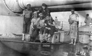 Sailors on the USS Indiana covered in soot from coaling.