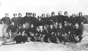 The USS Indiana Football team. Harry Fox is in the front row holding the team's mascot, a bulldog.