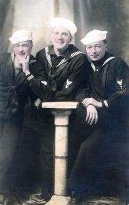 Harry Fox (far right) and Floyd Bowers (center) in their blue enlisted uniforms, 1919. The insignia on Harry's uniform show he was promoted to Chief Commissary Steward.