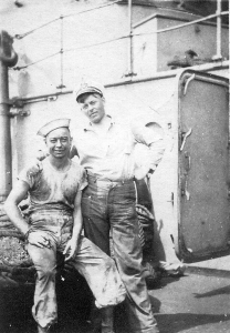Harry Fox (left) and friend. Harry is dressed in his undress white uniform after helping with coaling.