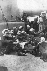 Harry Fox (far left) and shipmates relaxing on deck the USS Indiana.