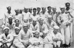 A group of sailors on the USS Indiana dressed in their undress whites.